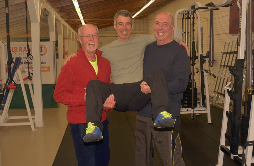 Ron and Wayne show the trainer some good lifting mechanics.